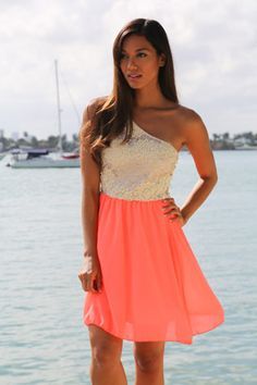 Adorable dress for summer. Love the combo neon coral and ivory. And the one shoulder design!