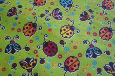 Weiche laminierte Baumwolle Wachstuch Marienkäfer Käfer Glückskäfer Blumen kiwi