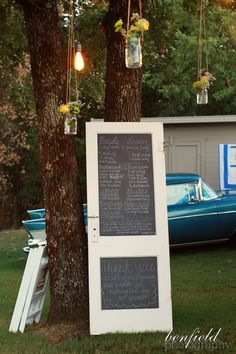 This is so neat! Chalkboard paint on the door as the wedding program...