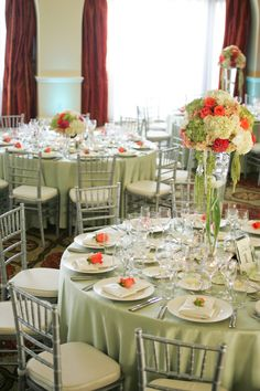 Orange | Green | White | Wedding Reception | Flowers by Cina    Beautiful. Sage tablecloths with white napkins from LinenTablecloth mixed with orange flowers makes that pop just right.