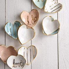 "Susan+Gordon+Heart+Ring+Dish+with+Gold+Edge+-+Go+ahead,+give+your+heart+away...or+keep+it!+Sweet+and+simple,+these+popular+heart+dishes+look+completely+charming+on+your+nightstand+or+vanity.+An+easy+gift+for+a+loved+one,+or+yourself,+to+create+smiles+year+round.+ 4""+W+x+4""+D+x+1""+H Handmade+with+white+stoneware+pottery+and+glazed+with+high+fire+glaze Features+22K+gold+luster+overglaze Not+food+safe,+hand+wash Due+to+handmade+nature,+each+piece+will+vary+slightly+in+color+and+finish C..."