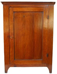 Southern Spice Cupboard, circa 1810, in cherry, out of Virginia.  The case is finely dovetailed with an applied molded cornice and the back boards are secured with cut nails.  The interior is divided with four cubby holes where there may have once been drawers, boot-jack end side panels. 36 H. x 24 W. x 10 D.