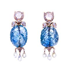 Carved Sapphire Diamond Dangle Earrings, Created in the Victorian style, these carved sapphires total more than 66 carats and are accented with rose-cut, round brilliant cut and briolette-cut diamonds. The diamonds total an estimated 7.00 carats. The earrings are made in 18 karat gold. 1stdibs.com
