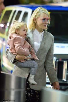 Matching:The talented actress and her daughter Edith both accessorised with pink and grey...