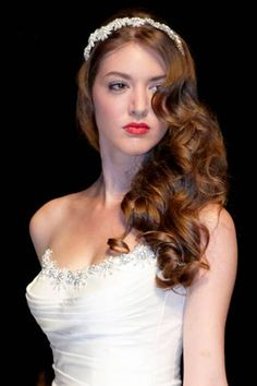 Dream wedding hair - asymmetric elegance.   Pin softly curled hair to one side for this timeless look.  See more gorgeous styles here: http://www.weddingmagazine.co.uk/beauty-article-Bridal%20hair%20trends.html