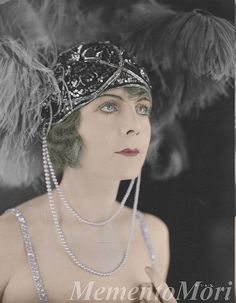 I swear this is my own grandmother. She was a stylish woman of society and had this exact face. 1920's headpiece