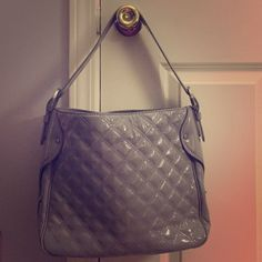 Authentic Michael Kors gray handbag excellent!! excellent condition !! no rips or tears. smoke free home. used only once or twice. no stains Michael Kors Bags Shoulder Bags