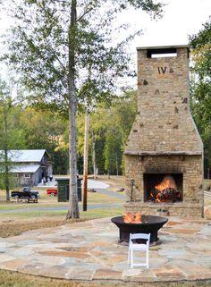 Wedding reception barn, wedding décor, outdoor fireplace and firepit. Rustic barn wedding and reception venue in Alabama whiteacresfarms.com