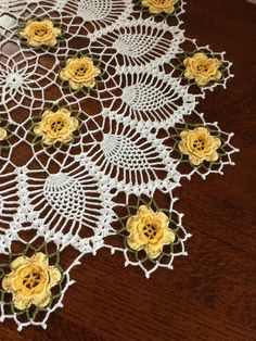 A beautiful designed by Mary Lou Davis. This is a hand crocheted yellow rose doily. It is measured 22 inches in diameter. It has been lightly starched (unscented). Beautify your home with this lovely rose doily. Great for table centerpiece, coffee tables, entryway display or just