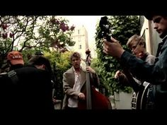 Mumford and Sons. In France. Live. Serenading a woman in her backyard. Singing in French. What more do you need, here?