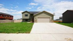 312 Edelweiss Ln. Box Elder, SD 57719.  MLS # 123776, Price: $214,900. Delightful split foyer home that is clean-lined and welcoming. The upper level offers an airy open feel and features vaulted ceilings, functional kitchen with breakfast bar, dining room with access to deck and sun-kissed living room. This home creates a very comfortable living space with all the natural light, beautiful flooring, and stylish finishes. For more information, visit: http://tour.circlepix.com/home/JZKFC2