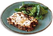 Moussaka  1 lb. ground lamb  4 eggs, slightly beaten   3 chopped onions   2 tbs. flour   2 cups water or vegetable stock   1/2 cup tomato paste mixed with 1/4 cup water   2 cloves garlic, crushed or cut into small pieces   1 tbs. corn starch   2 tbs. oil   1 tsp. salt
