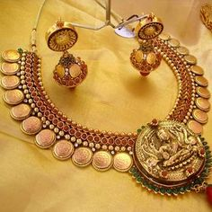 Latest Indian Gold and Diamond Jewellery Designs: Ruby Kasu Mala Necklace Set with Lakshmi Pendant Indian Wedding Jewelry, Indian Jewelry, Bridal Jewelry, Silver Jewelry, Silver Necklaces, Tanishq Jewellery, Temple Jewellery, Diamond Jewellery, Gold Coin Necklace
