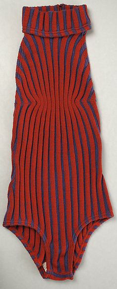 Ribbed red and blue wool knit backless bathing suit with turtleneck collar, by Rudi Gernreich, American, 1966.