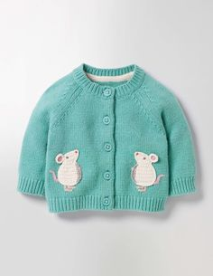 What could be cuddlier than your baby in a supersoft cardigan? We've taken the cuteness factor even higher by adding crocheted furry friends to this one. It's perfect for layering over jersey dresses on chilly days. And it's machine washable, so you can easily take care of little spills.