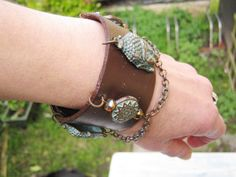 Buddha Heads Leather Wrist Cuff With Ornamented by LeChatCrochet
