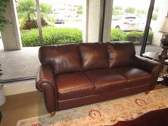 "Price: $649.99 Item #: 40210 A leather three-seat sofa from Italsofa. In a warm brown color, this would be a nice addition to a living/family room. It measures 82"" long x 36"" deep x 34"" high."