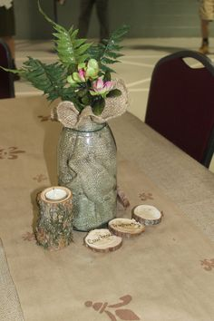 Eagle Court of Honor: The table centerpiece: Old blue Mason jar with burlap, wooden discs cut thin with the Scout Law written on them, candle holders cut from small logs and drilled out to hold a tea light.