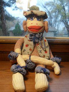 Vintage Sock Monkey in hat and vest.
