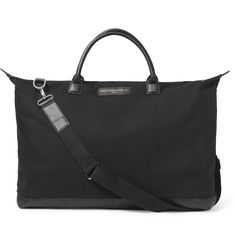 From their hometown of Montreal, Canada, twin brothers Mr Messrs Dexter and Mr Byron Peart design each WANT LES ESSENTIELS piece with 'intelligent simplicity' in mind. Featuring a detachable shoulder strap, durable leather base and multiple internal pockets, this black organic cotton-canvas holdall neatly illustrates the label's considered yet understated aesthetic.