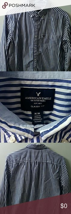 American Eagle casual long sleeve Shirt is white with blue stripes and has a pocket on the front. Very well taken care of and has no staining anywhere. Excellent condition, beautiful color and negotiable price. Has a dark blue eagle logo on the pocket. American Eagle Outfitters Shirts Casual Button Down Shirts