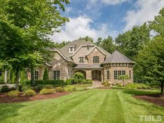 Custom home in North Raleigh with home theater and swimming pool. Moving to Raleigh, NC? Contact Marc Langefeld, REALTOR. Call 919.749.1117. Email langefeldm@hpw.com.