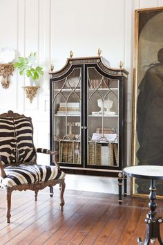 Ebanista zebra chair and ebony vitrine