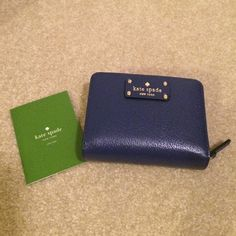 Kate Spade  Cara Wellesley wallet Emperorble Brand New!  This small wallet is the perfect for those small holiday purses.  It has 5 card holder.  Dual change holders with zipper and an outside slot for your ID or a tip for the taxi driver .  Must have for the holidays  kate spade Bags Wallets