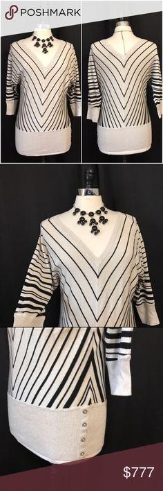 White House Black Market V-Neck Chevron Sweater 🦄 Size small. Dolman sleeves. Buttons on hem. Material is rayon, nylon, polyester & metallic. 🦄 White House Black Market Sweaters V-Necks