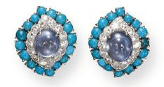 A PAIR OF SAPPHIRE, TURQUOISE AND DIAMOND EAR CLIPS, BY DAVID WEBB  Each clip centering upon a cabochon sapphire, within a circular and cabochon turquoise frame, mounted in 18K gold and platinum