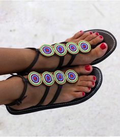 Colourful and bold, the Sabaki is the perfect african adaptation of the gladiator sandal. Whilst offering your feet support with the ankle strap. Go boho chic with a long dress or casual with denim shorts and accessorise with some Masai jewellery.  Handmade in Kenya.  Thong style sandal.  Adjustable leather ankle strap.  Genuine leather upper (dyed  sun dried).  Flat flexible rubber sole (0.4).