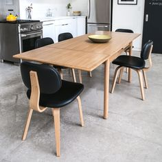Gus* Modern | The Portage is a Scandinavian-inspired extending dining table designed specifically for small space living. The integrated leaves extend from beneath the tabletop to accommodate extra dinner guests, then easily retract for the next day's breakfast. The inner extension system is engineered with all solid wood parts. Features solid wood legs, skirt and edging for durability.