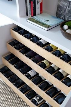 Amazing living room features built in shelves and cabinets fitted with pull out wine shelves.