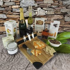 What a way to celebrate! Champagne Gift Baskets, Cheese Cutting Board, Marinated Olives, Gourmet Cheese, Gourmet Gift Baskets, Artisan Cheese, Cheese Lover, Cheese Spread, Champagne Bottles