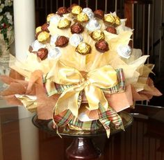 This Thanksgiving, dress your table up with one of our delectable chocolate bouquets. Made from decadent Ferrero or Lindt chocolates, these. Chocolate Flowers, Chocolate Bouquet, Ferrero Rocher Bouquet, Ferrero Chocolate, Candy Arrangements, Chocolate Hampers, Holiday Baskets, Fall Candy, Sweet Trees