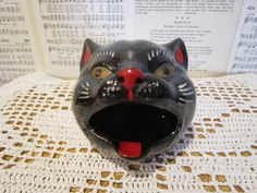 Hey, I found this really awesome Etsy listing at http://www.etsy.com/listing/176852700/black-cat-ashtray-japan