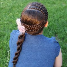 """""""Two Dutch lace braids and one regular Dutch braid into a rope twist ponytail on my daughter. Simple and pretty, and I love the sunset shining on her hair """" Photo taken by @thebraidparadenj on Instagram, pinned via the InstaPin iOS App! http://www.instapinapp.com (05/19/2015)"""