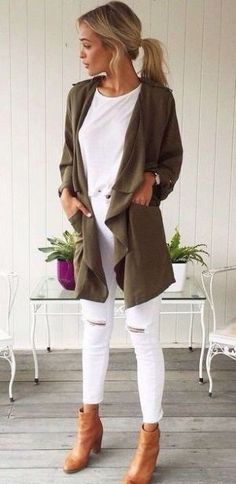 White jeans and tee, olive jacket, tan boots.