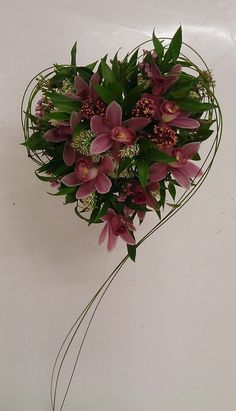 Beautiful heart bouquet created with Burgundy Cymbidiums Floral design by Lenka Natratilova - Thank you for sharing your design!