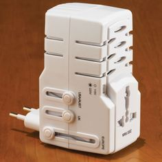 The 150 Country Travel Power Converter ::  [$  19.95] :: This is the palm-sized device that provides power and plug adaptation for over 150 countries worldwide. It automatically detects incoming voltage up to 2,000 watts (and 240V), converts it to 120-volt AC power, and covers Europe, Africa, Asia, the Americas and Caribbean, and Australia.