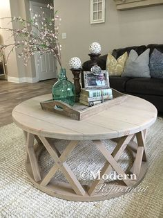 Stunning handmade rustic round farmhouse coffee table. Just the right accent piece to add to your home. The table is handmade, solid wood and treated with a lovely weathered stain. Has a protective finish to bring out the woods natural beauty. These tables can be customized with any dimensions as well as color combinations. Message me for more details. Dimensions 42 round 17 tall Farmhouse table. Coffee table. Dinning table. table. Farmhouse. Rustic. Buffet. Sofa table. Table. Entry way…