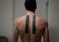 symmetrical, minimalist tattoo by Maxime Buchi