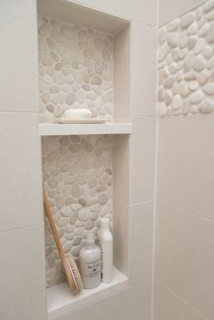 Pebble tiles in shower niche