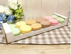 12 holding Macaron packaging - 4 different colors Black, Mint, Pink and White. $22.00, via Etsy.