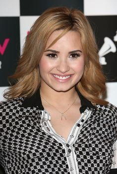 Hair Lookbook: Demi Lovato wearing Long Wavy Cut (8 of 12). Demi Lovato chose soft wavy tresses for her look at the promotion event for her new album.