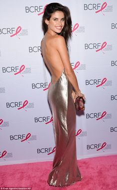 Silver siren: Sara Sampaio ensured she stood out from the crowd as she attended the Hot Pi...
