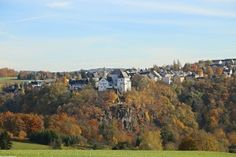 Wolkenstein Stadt und Burg über der Zschopau im Herbst