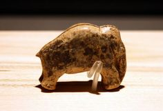 Ivory Carving of Mammoth, Vogeherd cave, Germany, from about 33.000 BCE. A rare treasure of prehistoric sculpture.