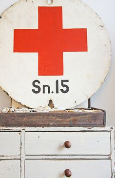 * Jenni Bowlin * Red Cross - not only a worthy cause, but also a great decorating choice. This sign had to be mine. Cowboy Theme, Vintage Medical, American Red Cross, Rustic Signs, Industrial Style, Red And White, Black, Jenni, Display