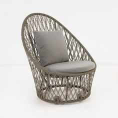 An incredible outdoor relaxing chair made with a stylish open weave and gorgeous attention to detail. Swivel base; Sunbrella cushions, high back; outdoor capable materials.
